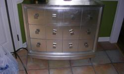 VERY STURDY 3 DRAWER DRESSER 34 INCHES HIGH 36 INCHES LONG AND 30 INCHES DEEP MADE OF A HARD WOOD AND IS SILVER COLOR. VERY GOOD CONDITION SOLD NEW FOR MUCH MORE. VERY GOOD QUALITY. MUST SEE TO APPRICATE.