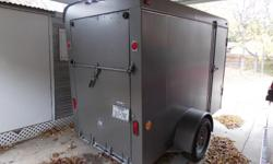 """brakes, good tires, spare tires, clean, side locking and rear fold down ramp doors. Has a roof vent. Inside Dimensions: 4' 10""""X 9' 6"""" (5x10) built strong. Registered and titled"""