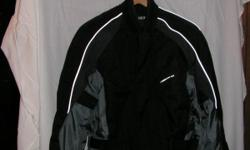 First Gear Womens jacket in excellent condition. Waterproof, insulated with shoulder and elbow pads.
