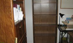 brown laminate bookshelf; 4 shelves