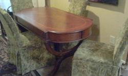 Traditional style dinning table and 4 parson chairs. Beautiful. Paid $1600.00. Sell: $250.00. cash only. --
