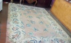 this beautiful carpet is hand made 100% wool Obeson floral design .. This is a Vintage rug and in great condition.. 9 X 7 Feet