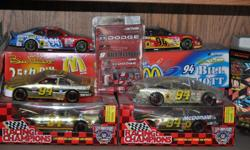 a collection of 1/24 & 164 scale cars and trucks and related material covering most of his racing career in nascar.Pics only show half of collection