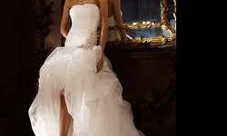 This is a brand new dress (tags still on it) - Size 14. Strapless organza high-low ball gown is breathtaking with pickups and adorned with beaded detail at the dropped waist. It is currently on back order at David's Bridal for another six