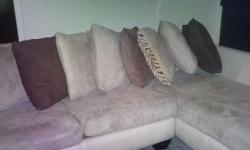 THIS is not a scam COLOR IS LIGHT WHEAT/ cream see pics Absolutely BEAUTIFUL.....This is the a left arm $ suede sectional sofa $$ with a right arm chaise....SEE STORE FOR A MATCHING CREEN OTTOMAN its around out call me at 402-991-9706