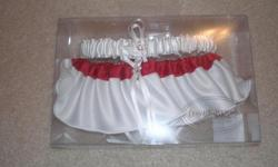 Wedding Garter. New, remains in original packaging. Purchased from David's Bridal. Red and White satin.