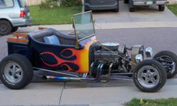 Nice..1927 Ford T-Bucket..blue metal flake with flames..4 speed standard transmission..8 cylinder chevy engine..edelbrock intake..electric fuel pump..headers..holley car..disc brakes..speedway shocks..9 inch ford rear end..cragar wheels with new