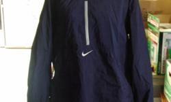 Nice Nike reversible windbreaker with hood, size XL. In terrific condition. Dark blue on one side, and red and dark blue on the other. Tag is in the pocket.
