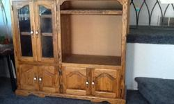 """Solid oak entertainment center 53"""" wide by 47"""" high TV opening 25"""" wide by 21"""" high"""