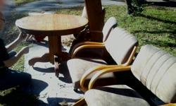 OAK TABLE WITH 2 LEAVES & 4 rolling chairs. For more pics text