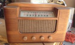 A restored 40's model radio (exterior only)--Nice conversation piece of yesteryear--might be able to fix it completely (inside tubes-etc)
