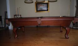 Olhausen 8' Pool Table - American made, Excellent Condition includes cues stand, cues, balls and felt brush.  Felt replaced last year. Three separate pieces of slate so it's assembly is relatively easy. Moving to California and need to sell.