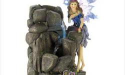 NEW IN THE BOX'LIGHTED FAIRY FOUNTAIN AND FREE SHIPPING. A lavender fairy pauses beside an enchanted waterfall, delighting in the water's sooting song. Lighted fountain adds story book fascination to your home, office or garden! Weight 4.2 lbs. Polyresin.
