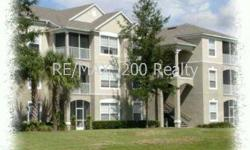 1st Floor Condo in a gated community w/ beautiful lake view. Open floor plan with 3 bedrooms/ 2 baths. Vinyl flooring and carpet throughout. Appliances include refirgerator, stove, microwave, dishwasher w/ washer & dryer included!. 1 car carport and