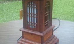 Pagoda Lamp made of solid wood and cascades a shadow of light from within it. Asking $30.00 or best offer. Call --