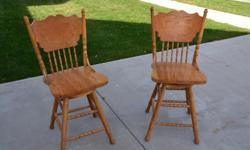 Like brand new...swivel bar stools-24in. tall seat....40in. to back Call Ralph for info: 843-488-2227