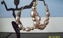 This hoop earring is made of freshwater pearls,gold filled wire balls and 14/20 gold filled wire. Earring can be made with different stone of your choice .just give me a ring or visit me at www.mgjewelry4u.com