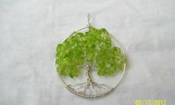 Tree of life pendant with peridot chips stone .. also sterling silver .you can find this in my website www.mgjewelry4u.com All of my jewelry are handmade from the heart.