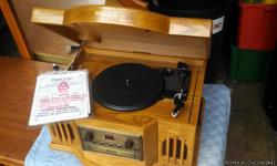 """Philco Turntable CD with Cassette (Art no. 841.205), Playscassette/CD/phonograph,Specification:Power Consumption: 23W, Power Source: AC 120V/60Hz, Speaker: 4"""" Dynamic Type x2, Tape Speed: 4.75 cm/sec,Wow and"""