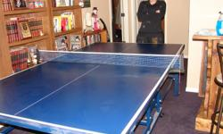 Full size ping pong table. This is a very well made, sturdy table that is in great condition. It folds up for easy storage and is on wheels for easy moving. This would make a great family activity.