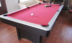 Nice 3 1/2' X 7' red felt pool table, with several high quality tow piece sticks, rack, balls and other accessories. Contact by phone only.