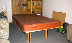 Full size pool table - good shape - has pool sticks with hanging holder, pool balls and rack.