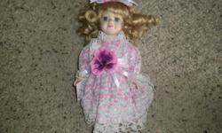 porclien doll like new