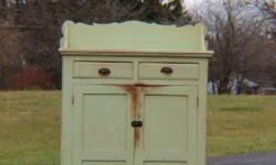 This is a rare find and will add an accent piece to any decor. This primative cabinet is probably around 80 to 90 years old and in excellent condition. This is a piece for the serious collector. The cabinet is 40 1/2 inches wide and 60