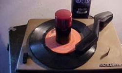 Up for SALE is a very good looking RCA automatic return phonograph.Unit model 45-J-2 is in good condition, unit spins, drops a record, and plays at the correct speed. Selling it for parts or restoration because the phono wire has a short in