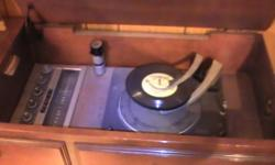 Recordplayer with AM and FM radio. Everything works like it is new. Excellent condition.