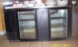 """True 2 door reach-in """"under-counter if needed"""" can/bottle cooler. 5ft 6in wide x 2ft 3in deep x 3ft 2in high. Black sides and front, with stainless top. Cooler runs great, however, you will need to frabricate a drip pan for condensation and reconnect the"""