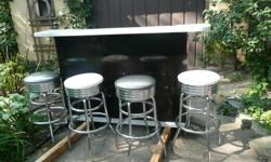 Black & White Laminated Bar & 4 stainless steel retro bar stools Will sell bar & stools seperate ......$ 100.00 for Bar $ 50.00 each for bar stools came from Billy Bobs recreation store