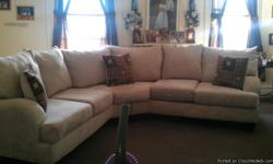 Cream coler new with three pillow and foot stool