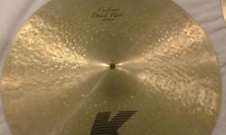 Zildjian K Custom Dark Ride 20 that was initially bought for $400 and now selling. It is in great condition without any cracks or dents however does have a tape mark residue trying to dampen the amount of wash  as you can see from the last picture