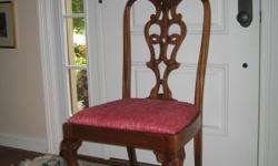 Just in time for the holidays..... Beautiful antique mahogany chairs with claw and ball feet and intricately carved backs. Very good condition. Purchased from Beauchamp Antiques for $300 a chair. One of the chairs has a leg that has been repaired by an