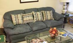 Sleeper Sofa, color Ocean Blue, stain protected, pillows included. Like new condition. Matching Love Seat available (See other ad).