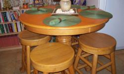 SOLID ASIAN WOOD PUB TABLE WITH 4 STOOLS . Why pay alot for Formica and MDF when you can have solid wood! Table and stools have EAGLE TALONS at the base of the legs. EXCELLENT CONDITION. Each stool weighs Approx. 50 LBS. EACH. PAID $1800.00 ALMOST 2 YEARS
