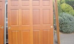"""Beautiful, high quality solid wood (fir), six-panel, two-doorslider sets with all hanging hardware and matching wood trim boards. Medium-dark pecan stain. Each door measures 36"""" x 78.5"""". Two sets of two doors available."""