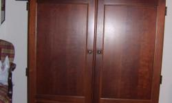 """Beautiful Piece of Furniture by Riverside Holds TV and Stereo Equipment. Doors open and fold back against side of stand. Dimensions are as follows: 41 1/2"""" wide (outside dimension)"""