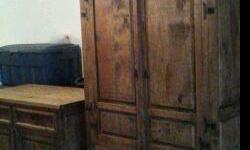 Solid wood Armoire, deminsions 47in wide, 77in tall and 22in deep; and Buffet, deminsions, 49in wide, 37in tall and 27in deepnatural stain southwest design in very good condition.