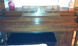 A great spinet piano for sale.  It has recently been reduced to 350.00 for quick sale. Call Bob  at --