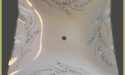Ceiling Light Shade For sale is a ceiling light globe. The globe is frosted with plant designs. This is the type that is held on by 1 nut and a threaded shaft. The globe is in perfect condition. These type of globes are getting