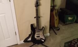 Black & Chrome Squire Electric Strat. Like new condition. w/soft case.