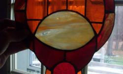 """this is a hand made glass dream catcher beauitful oranges and reds. it is 9"""" across at the middle and 13"""" long. will not ship but will make arrangements with you to get it to you safely. (for it is real glass don't want it to break) in the erie area of"""