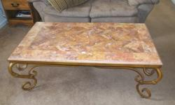 Beautiful stone inlay table measuring 27x49 inches...expert craftsmanship and in excellent condition... the bottom part is victorian style iron...This table is VERY heavy, but I can help load.