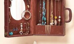 http://littlebitofeverything5973.tictail.com/product/suitcase-jewelry-cabinet This vintage-inspired suitcase is designed to serve as a wall-mounted jewelry and accessories storage cabinet. The brown leather-look case resembles a suitcase right down to the