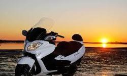 Garage kept& Showroom condition Suzuki Burgman 650 with abs Pearl White/Black. Can get 55 MPG. and top speed of over 140 MPH. Goodtires. 17K miles like new condition, but much cheaper. Burgman 650 Executive it has all the great