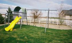 Large Metal Tubular Commercial Quality Swing Set, With 3 Swings, Monkey Bar, Slide, Jungle Gym and covered club house.