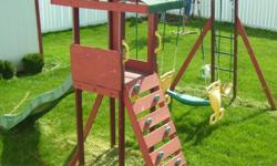 Wood Swing set with swing, glider, slide, tower w/ climbing board. Call 402-455-1405 after 5 pm