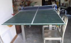 This is a home made ping pong table with a set of 4 aluminum look chairs and faux oak top table. Moncks Corner. Great for the man cave or FROG.